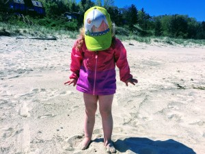 Sawyer loving the feel of sand on her toes