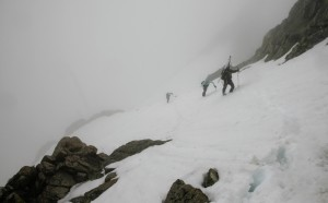 J, Kristine, Billy, & Mikey climbing the steep snow into the clouds