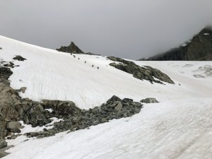 Our two teams climbing steeper snow to attain the Gooseneck Glacier and bergshrund